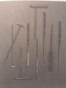 Freeman-Watts Leucotomes. L-R, two modified icepick leucotomes for standard transorbital lobotomy; curved leucotome for radical prefrontal lobotomy; blunt-edge leucotome for prescision-method lobotomy; curved leucotome; blunt-edge leucotome, side view' leucotome for deep-frontal-cut transorbital lobotomy; original icepick leucotome; deep-frontal-cute leucotome.